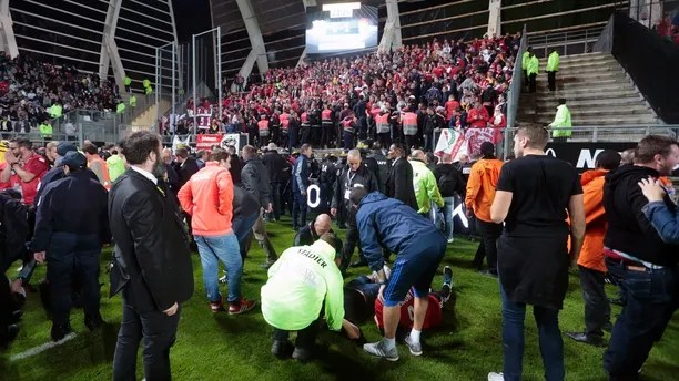 Medics tend to wounded Lille' supporters following the fall of a barrier during a French League One soccer match between Amiens and Lille in Amiens, northern France, Saturday, Sept. 30, 2017. Three Lille supporters have been seriously injured and taken to hospital after a barrier collapsed during the side's football match at Amiens. Lille says 17 other fans were also injured. (AP Photo)