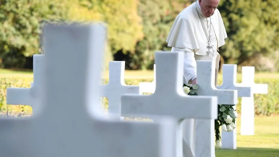 Pope Francis pays a visit to the American military cemetery in Nettuno, Italy, Thursday, Nov. 2, 2017. Pope Francis is underlining the price of war, visiting an American military cemetery and the site of a Nazi massacre in Rome. The pope will first say Mass in the Sicily-Rome American Cemetery, where 7,680 American war dead who helped liberate southern and central Italy during World War II are buried and 3,095 missing are commemorated. (L'Osservatore Romano/Pool Photo via AP)