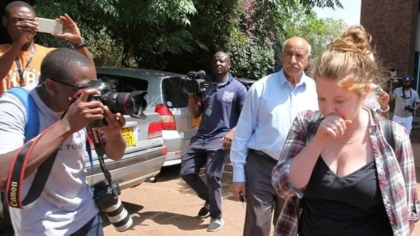 U.S. citizen Martha O'Donovan arrives at court in Harare, Zimbabwe, November 4, 2017. O'Donovan was charged on Friday with attempting to overthrow the Zimbabwean government, which carries a sentence of up to 20 years in jail, after police earlier accused her of insulting 93-year-old President Robert Mugabe. REUTERS/Philimon Bulawayo - RC14E2B285F0