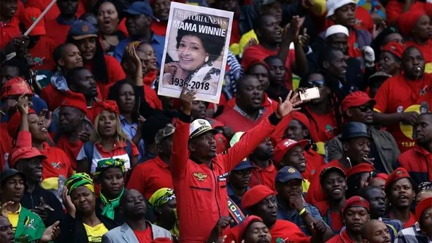 Mourners attend the funeral of struggle icon Winnie Madikizela-Mandela, at the Orlando Stadium in Soweto, South Africa, Saturday, April 14, 2018. Madikizela-Mandela died on April 2 at the age of 81. (AP Photo/Themba Hadebe)