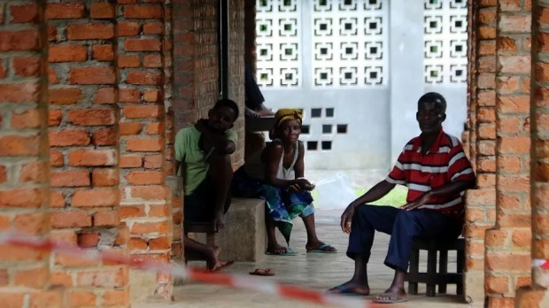 People suspected of having the Ebola Virus wait at a treatment center in Bikoro Democratic Republic of Congo, Sunday, May 13, 2018.