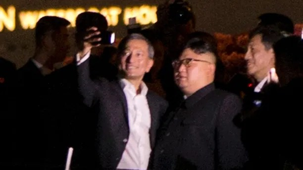 In this photo released by the Ministry of Communications and Information of Singapore, North Korean leader Kim Jong Un, right, arrives at the Changi International Airport, Sunday, June 10, 2018, in Singapore ahead of a summit with U.S. President Donald Trump. (Ministry of Communications and Information of Singapore via AP)