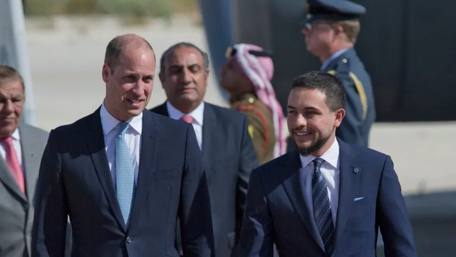 Britain's Prince William with the Jordanian Crown Prince Hussein at Marka Airport in Amman, Jordan, on Sunday.
