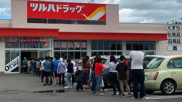 People line up outside a supermarket due to rush to buy supplies after an earthquake, in Biei town, Hokkaido, northern Japan, Thursday, Sept. 6, 2018. A powerful earthquake shook Japan's northernmost main island of Hokkaido early Thursday, causing landslides that crushed homes, knocking out power across the island. (Mika Takeda via AP)