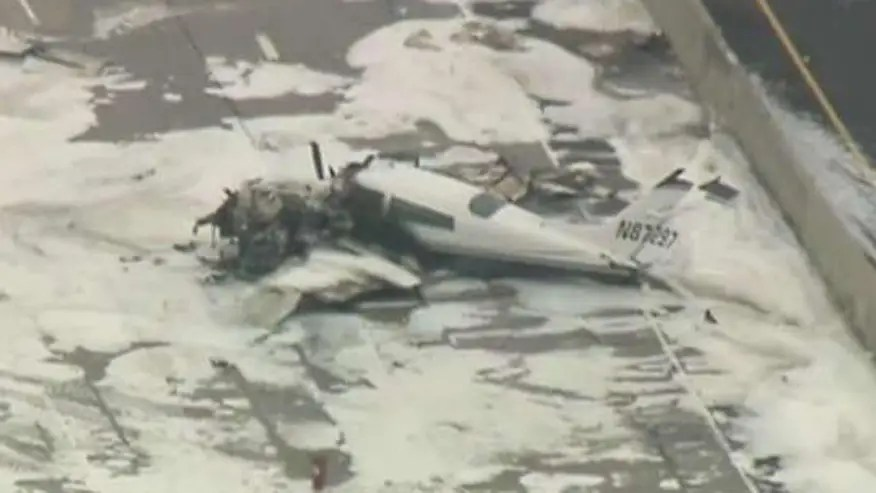 Twin-engine Cessna was on final approach to John Wayne Airport; blocks 405 freeway in Costa Mesa