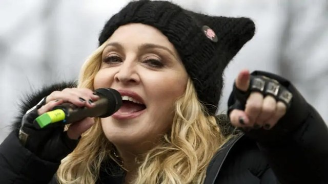 Madonna stops an impending auction of her highly personal items that include a hairbrush, personal photos, underwear, and a love letter from rapper Tupac