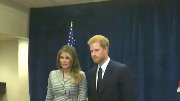 First lady meets Prince Harry during her first solo international trip