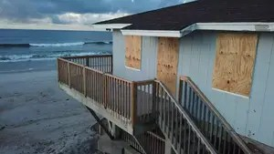 Drone footage shows North Topsail Beach, North Carolina after residents board up and evacuate their homes before Hurricane Florence is expected to arrive.