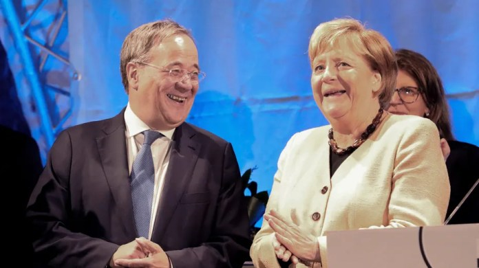 Armin Laschet, the president of the German Christian Democratic Union (CDU) and the party's top candidate for the federal election, left, and German Chancellor Angela Merkel attend a joint campaign appearance in Stralsund, Germany
