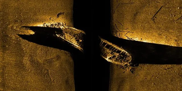 FILE - In this file image released by Parks Canada, shows a side-scan sonar image of a ship on the sea floor in northern Canada. Sir John Franklin was likely sailing on the HMS Erebus vessel when it vanished along with another vessel 170 years ago, Canada's prime minister announced Wednesday, Oct. 1, 2014.
