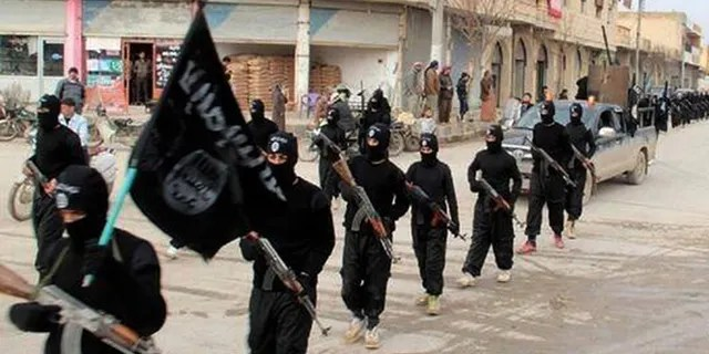 Jan. 14, 2014: Fighters from ISIS marching in Raqqa, Syria.