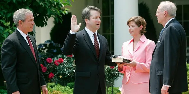 Ashley Kavanaugh holds a Bible as her husband, Brett Kavanaugh, is sworn in as a judge for the U.S. Court of Appeals for the District of Columbia. The two met working for former President George W. Bush.