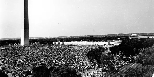 """On August 28, 1963, the file photo shows civil rights protesters gathering at the Washington Memorial Grounds before noon, before marching to the Lincoln Memorial, seen in the background on the right, with Washington for Jobs and Freedom The march will end with a speech by the Rev. Martin Luther King Jr., now known as the """"I Have a Dream"""" speech.  (AP photo, file)"""