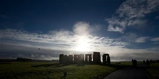 File photos on this Tuesday 17 December 2013, visitors take photos of the World Heritage Site of Stonehenge, England.