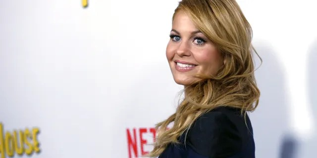 """Cast member Candace Cameron Bure poses at the premiere for the Netflix television series """"Fuller House"""" at The Grove in Los Angeles."""