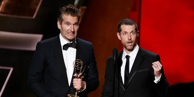 "David Benioff (L) and D.B. Weiss (R) accept the award for Outstanding Writing For A Drama Series for HBO's ""Game of Thrones"" at the 67th Primetime Emmy Awards in Los Angeles, California September 20, 2015."