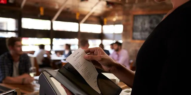 College basketball fans began showing their school pride by leaving messages supporting one team or the other on receipts with big tips.
