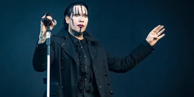 Marilyn Manson turned himself into authorities in Los Angeles in connection to assault charges he is facing in New Hampshire, Fox News has confirmed.