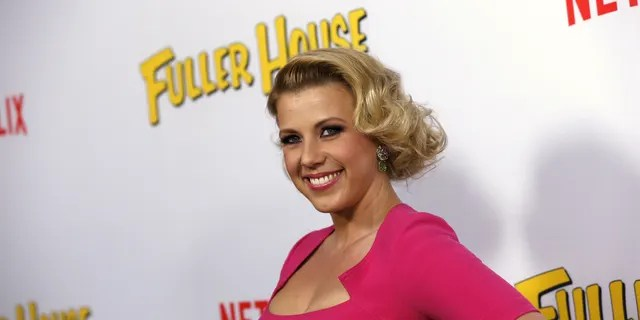 """Cast member Jodie Sweetin poses at the premiere for the Netflix television series """"Fuller House"""" at The Grove in Los Angeles, California."""