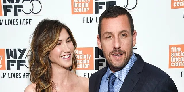"Adam Sandler credited his wife Jackie for giving him ""strength and courage"" to tackle his new role in ""Uncut Gems."" The movie was released Friday, Dec. 13."