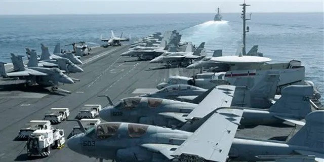 Aircraft parked on the flight deck of the USS Abraham Lincoln in this 2012 photo.