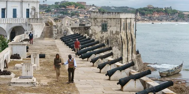 First lady Melania Trump tours Cape Coast Castle with museum educator Kwesi Essel-Blankson in Ghana on Oct. 3, 2018. The first lady is visiting Africa on her first solo international trip. (AP Photo/Carolyn Kaster)