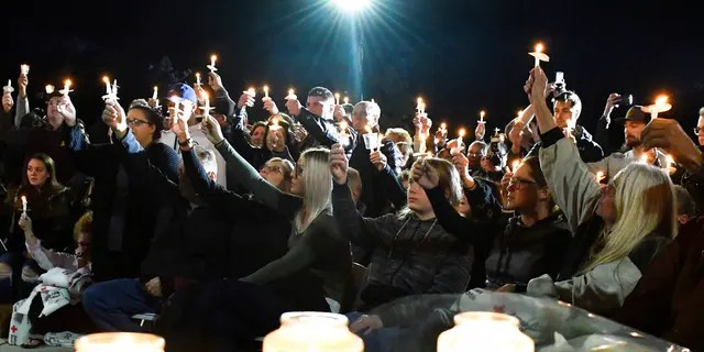 Family members and friends gathered for a candlelight vigil on Monday, to honor the 20 people who died in Saturday's fatal limo crash.