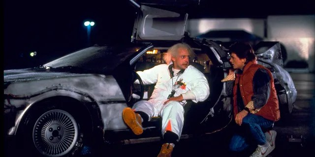 Christopher Lloyd, left, as Dr. Emmett Brown, and Michael J. Fox as Marty McFly in the 1985 film,