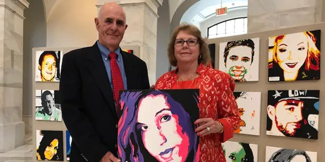 Anne Marie and Jim Zanfagna with portrait of their daughter Jacqueline