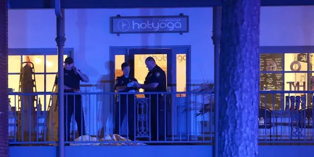 Police investigators shoot a scene in Tallahassee, Florida on Friday, November 2, 2018. One shooter killed one person and injured four others in a yoga studio in Florida's capital before killing himself on Friday. (AP Photo / Steve Cannon)