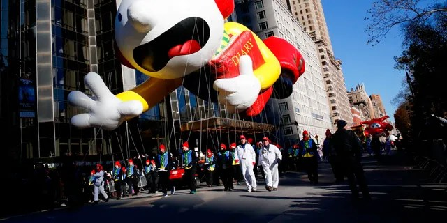 """Greg Heffley from the """"Diary of a Wimpy Kid"""" series balloon passes by windows of a building on Central Park West during the 92nd annual Macy's Thanksgiving Day Parade in New York, Thursday, Nov. 22, 2018. (AP Photo/Eduardo Munoz Alvarez)"""