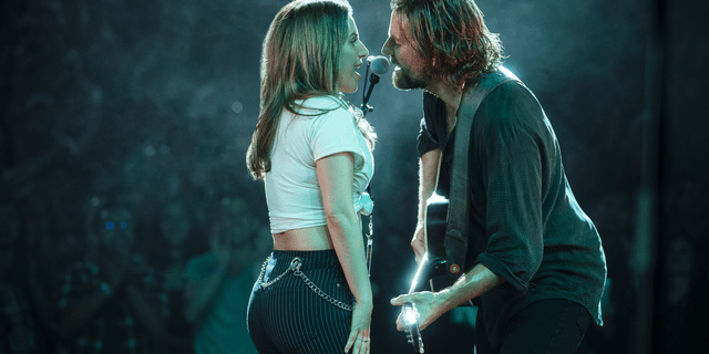 "Lady Gaga, left, and Bradley Cooper in a scene from ""A Star is Born."""