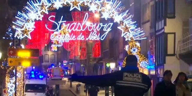 In this image made from video, emergency services arrive on the scene of a Christmas market in Strasbourg, France, on Tuesday.