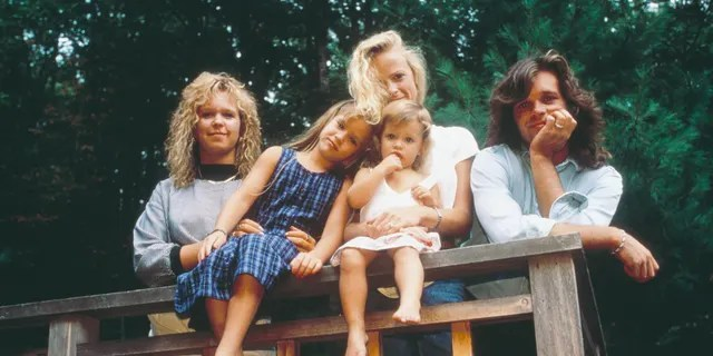 John Mellencamp poses with his daughters (left to right) Michele, Teddi Jo, and Justice, and his wife, Victoria in 1987.