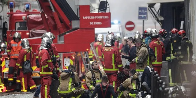Firefighters rest in the street after the explosion of a bakery on the corner of the streets Saint-Cecile and Rue de Trevise in central Paris on January 12, 2019.