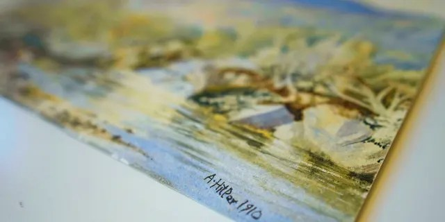 In this Thursday, Jan. 24, 2019 picture a watercolor landscape is displayed at an auction house in Berlin, Germany. Berlin police say three watercolor landscapes allegedly painted by a young Adolf Hitler are being examined by experts to determine if they are fakes. The paintings were seized from a city auction house before they could be sold after they had received a complaint questioning their authenticity. (Gregor Fischer/dpa via AP)