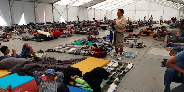 Central American migrants settle in a shelter at the Jesus Martinez stadium in Mexico City, in Mexico City, Monday, Jan. 28, 2019. Thousands of Central American migrants are waiting for Mexican officials to issue them humanitarian visas, which give them permission to be in Mexico for one year and work legally. (AP Photo/Marco Ugarte)