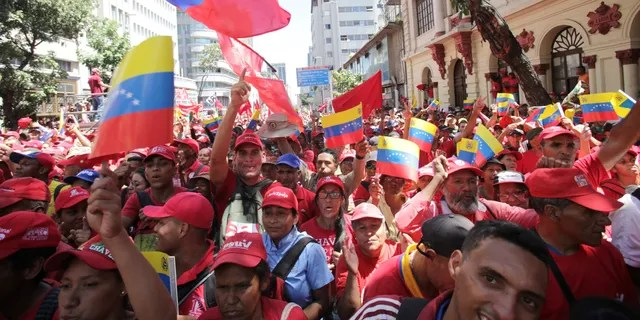 Supporters of President Nicolas Maduro cheer during a pro-government rally in Caracas, Venezuela, Saturday, Feb. 23, 2019. Maduro has closed Venezuela's borders and calls humanitarian aid destained for Venezuela part of a U.S.-led coup. (Associated Press)