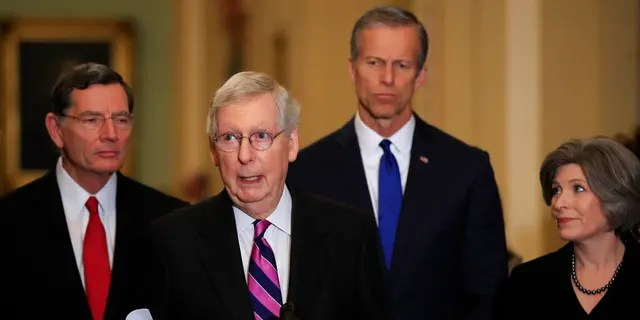 Senate Majority Leader Mitch McConnell, R-Ky., with, from left, Sens. John Barrasso, R-Wyo., McConnell, John Thune, R-S.D., and Joni Ernst, R-Iowa, speaks to reporters on Capitol Hill in Washington, Feb. 26, 2019. (AP Photo/Manuel Balce Ceneta)