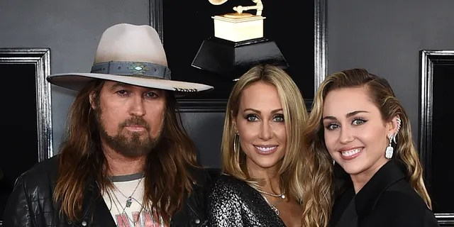 Billy Ray Cyrus, from left, Tish Cyrus, and Miley Cyrus arrive at the 61st annual Grammy Awards at the Staples Center on Sunday, Feb. 10, 2019, in Los Angeles.