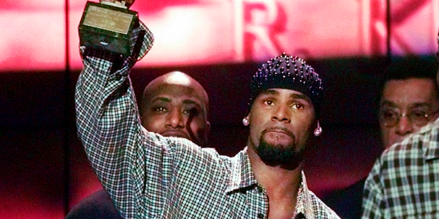 "FILE - In this March 26, 1999 file photo, R. Kelly accepts the Sammy Davis Jr. Award for Male ""Entertainer of the Year"" at the 13th annual Soul Train Music Awards in Los Angeles. (AP Photo/Mark J. Terrill, File)"