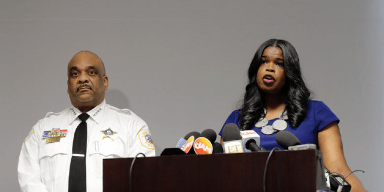 FILE - In this Feb. 22, 2019, file photo, Cook County State's Attorney Kim Foxx, right, speaks at a news conference as Chicago Police Superintendent Eddie Johnson listens in Chicago. (AP Photo/Kiichiro Sato, File)