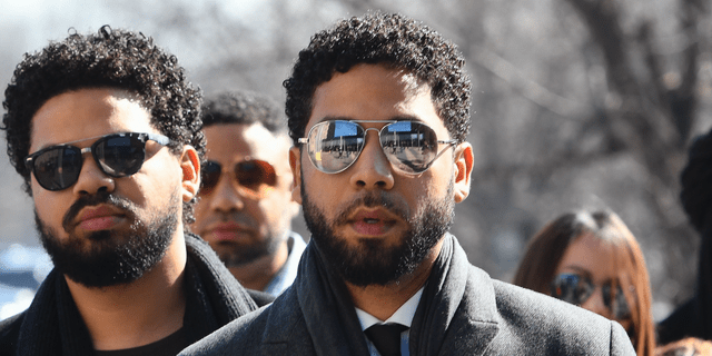 """Empire"" actor Jussie Smollett, center, when he arrived at Leighton Criminal Court Building on Tuesday, March 12, 2019, in Chicago.(AP Photo/Matt Marton)"