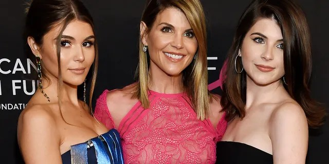 """In this Feb. 28, 2019 file photo, actress Lori Loughlin, center, poses with daughters Olivia Jade Giannulli, left, and Isabella Rose Giannulli at the 2019 """"An Unforgettable Evening"""" in Beverly Hills, Calif. (Photo by Chris Pizzello/Invision/AP, File)"""