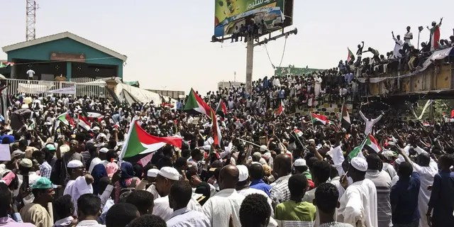 Demonstrators gather in Sudan's capital of Khartoum, Friday, April 12, 2019. The Sudanese protest movement has rejected the military's declaration that it has no ambitions to hold the reins of power for long after ousting the president of 30 years, Omar al-Bashir.