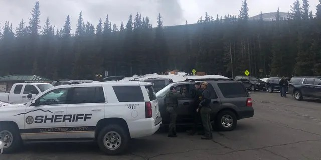 Clear Creek County Sheriff's vehicles can be seen near Echo Lake, Colorado, where Sol Pais was found dead on Wednesday.