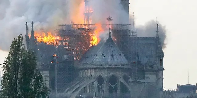 Flames rise during a fire at the landmark Notre-Dame Cathedral in central Paris on April 15, 2019 afternoon. (Photo by FRANCOIS GUILLOT / AFP)