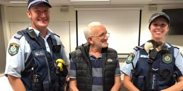 Police posed with the rat after it was reunited with its owner.