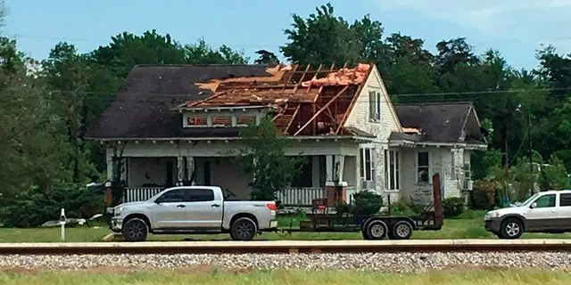 After a suspected tornado on Saturday, April 13, 2019 in Franklin, Texas, a roof will be demolished.