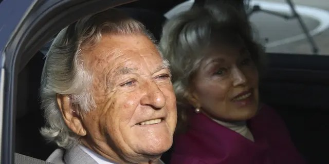 In this Sept. 2013, file photo, former Australian Prime Minister Bob Hawke, left, and his wife Blanche d'Alpuget arrive at the Australian Labor Party's campaign launch in Brisbane, Australia. Hawke, Australia's 23rd prime minister, has died in Sydney at age 89.